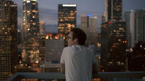 Her_overlooking_city